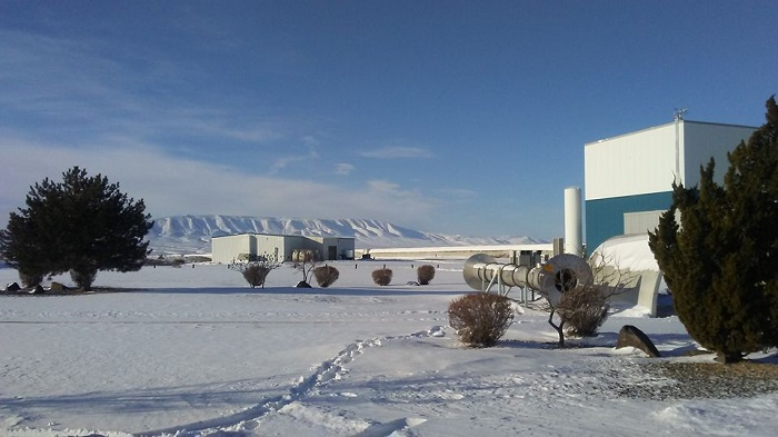 Fig. 1. The snowy landscape around the main building of LIGO Hanford detector on January 4th, 2017 at which GW170104 was observed.  The horizontal pipe in the middle of the picture is a part of 4-km Y-arm of the laser interferometer. (The picture was taken by Young-Min Kim when he arrived at the parking lot in the morning)